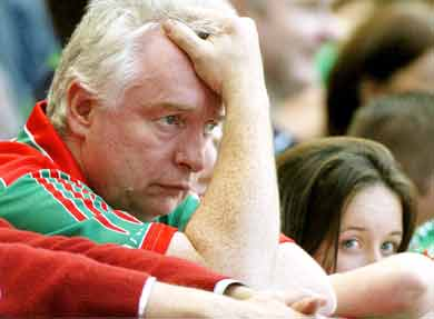 Disappointed Mayo Fan holds his head