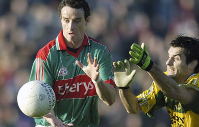 Mayo captain Kevin O'Neill beats Kerry's Tom O'Sullivan