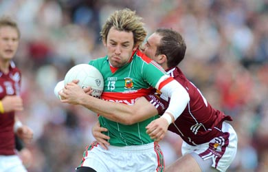 Galway's Damien Burke is all over Mayo's Conor Mortimer