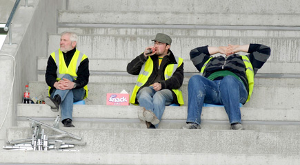 Workmen at McHale Park, Castlebar take a break to watch the Mayo match last Saturday. But it was hard to stay interested at times. Pic: Sportsfile