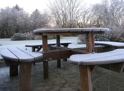A bench frozen over in Carrowholly