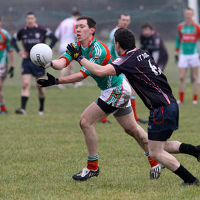 Mayo's Barry Kelly gets the ball away
