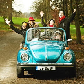 A group of people in an old VW Beetle