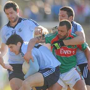 CROWDED HOUSE  Mayo's Trevor Mortimer is surrounded by Dublin's Bernard Brogan, Darren Magee and Conal Keaney during last Sunday's game.