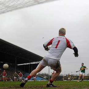 Mayo goalkeeper Robert Hennelly is powerless to prevent Kerry's Bryan Sheehan converting the 64th minute penalty that turned last Sunday's NFL match at McHale Park.