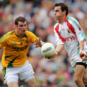 Kenneth O'Malley (pictured here with Meath's Cormac McGuinness) replaces David Clarke as Mayo's sub goalkeeper.