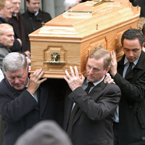 N Taoiseach Enda Kenny carries the coffin of his mother Eithne from the Church of the Holy Rosary in Castlebar