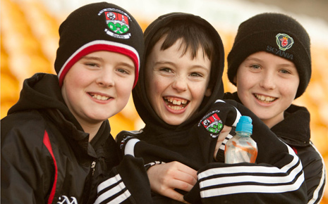 Young Davitts GAA supporters Niall Kearns, Joe Prendergast and Colin Mulligan were all smiles in Tullamore last Sunday as they watched their team qualify for the AIB All-Ireland Intermediate club championship final next month.