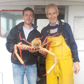 Skipper Micheal O'Toole (right) and crewman Darren O'Toole holding the Giant Box Crab which they caught while fishing off the the stags of Inishbofin on the vessel the Inisgalloon last Tuesday.