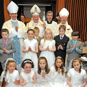 Papal Legate Cardinal Marc Ouellet (PSS), Papal Nuncio; Apostolic Nuncio, Archbishop Charles Brown; Fr Richard Gibbons, PP, Knock and Archbishop Michael Neary after celebrating Mass in Knock Shrine are pictured with First Holy Communicants on Saturday.