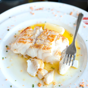 White fish in a butter, lemon and white-wine sauce.
