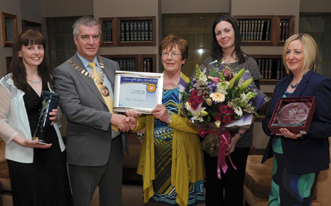 Cllr Christy Hyland, Cathaoirleach, Westport Town Council, presenting Bridie McLoughlin, Bohea, Liscarney with both her Mayo and Connaught/ Ulster Carer of the Year awards. Included at a reception in the Plaza Hotel were, from left: Eileen Mc Namara, Outreach Development Officer; Karen Phelan, Project Manager, Carers Association, and Anne Marie Campion, Westport, who nominated Bridie for the award.