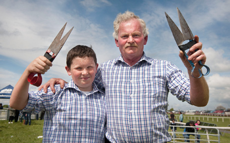 Ben Burke Jnr and Ben Burke Snr from Foxford donned similar attire on Sunday when they attended the Connacht Spring Show at Ballinrobe Racecourse. Over 150 sheep-shearers set a new world record during the show. See our unrivalled coverage of the event on pages 20/21.