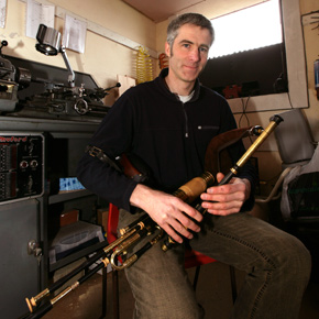 John Butler is pictured making and playing the uilleann pipes in his studio in Achill.