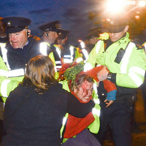 A protester is forcibly removed as trouble flares between Gardai and protesters as the first of the low loaders carrying the TBM passes through Bellacorrick recently.