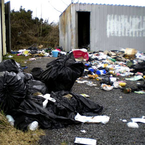 Pictured is just some of the 8.2 tonnes of rubbish dumped at a sportsground at Carramore, Knock last year. A local woman was jailed in connection with some of the dumping this week.