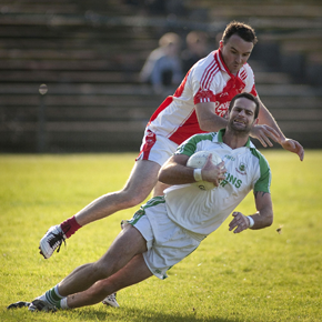 Ballaghaderreen midfielder James Kilculllen is challenged by Ballintubber's Damien McGing during last Sunday's Mayo SFC Final at McHale Park, Castlebar.