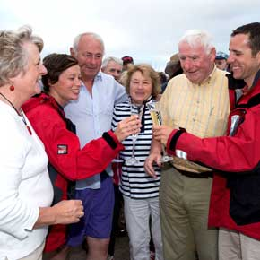 Myles Henaghan (from Louisburgh) and his wife Eithne Sweeney (from Castlebar) are welcomed by their parents JJ and Kathleen Sweeney and Louis and Pat Heneghan as they arrived on the pier at Old Head last Sunday evening.