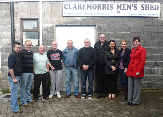 The committee of Claremorris Men's Shed are pictured with staff of Claremorris Family Resource Centre last week.