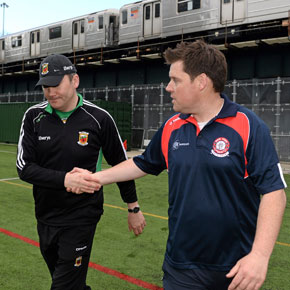 Mayo manager James Horan shakes hands with his New York counterpart Ian Galvin.