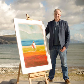 Artist Padraig McCaul with one of his paintings, 'Family Time on Keel'.