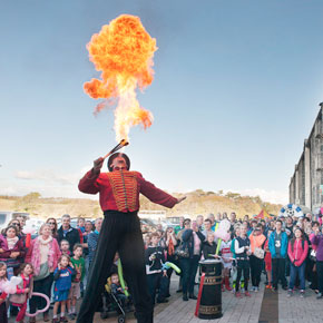 Mayo County Council and Westport Smarter Travel celebrated the official opening of the magnificent new civic space at Westport Quay with a special 'Spraoi at the Quay' family fun day last Sunday. A fire-eater is pictured burning up the blue Autumn sky in front of the large attendance.