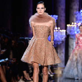 Elie Saab's autumn/winter 2014 sparkling rose-gold dress with faux fur stole, at Paris Fashion Week.