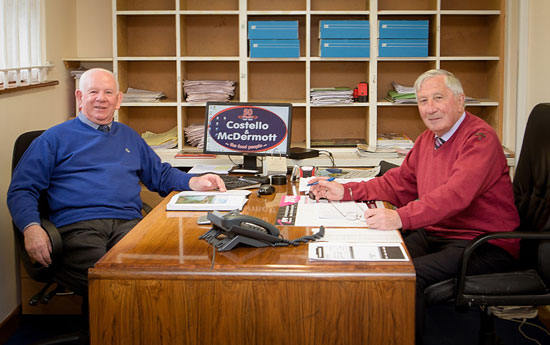 Eamon McDermott and Peter Costello are pictured at work.