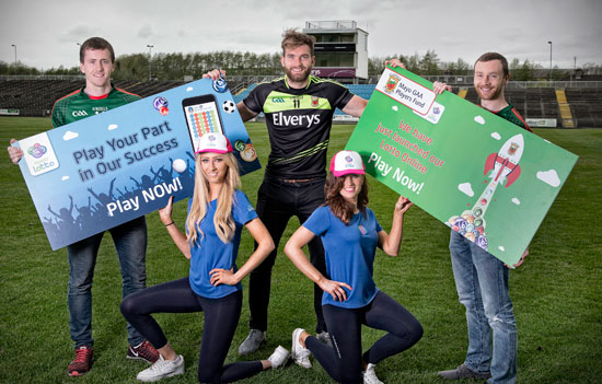 Mayo footballers Cillian O'Connor, Aidan O'Shea and Keith Higgins are pictured at the launch of the Mayo GAA Players Fund Lotto last week at MacHale Park, Castlebar. Also there were Caoimhe Drumm (front left) and Amy Moore.