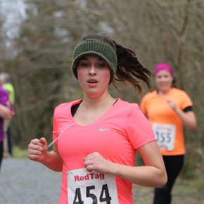 Ciara Galvin, and her lucky woolly visor, during the Claremorris Lake 10k. (Picture courtesy of Breda Raftery.)