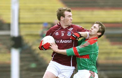 Mayo captain Ronan McGarrity feels the full force of Galway's Barry Cullinane