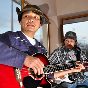 Karen men Nay Sui (left) and Kwee Kwee at music lessons in Castlebar.