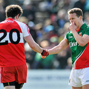 Mayo captain Andy Moran shakes hands with Derry's Emmett Bradley after last weekend's Allianz Football League clash.